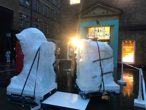 Two Bluewater Forklifts and drivers lifting Ice sculpture at covent Garden, London